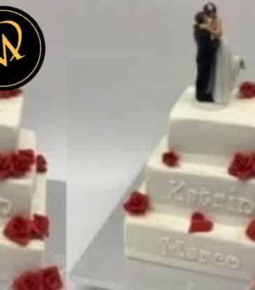 Hochzeitstorte eckig mit roten Rosen